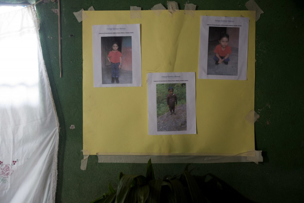 A poster with photo copies that show Felipe Gomez Alonzo is taped to a wall as part of a makeshift altar honoring the 8-year-old, inside his mother's ...