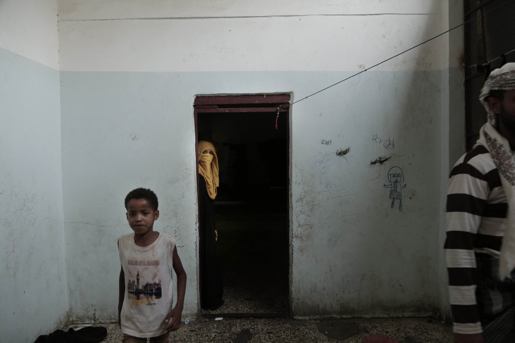 People walk in a shelter for displaced persons in Ibb, Yemen, in this Aug. 3, 2018, photo. Even with food aid that makes it into Yemen, 15.9 million o...