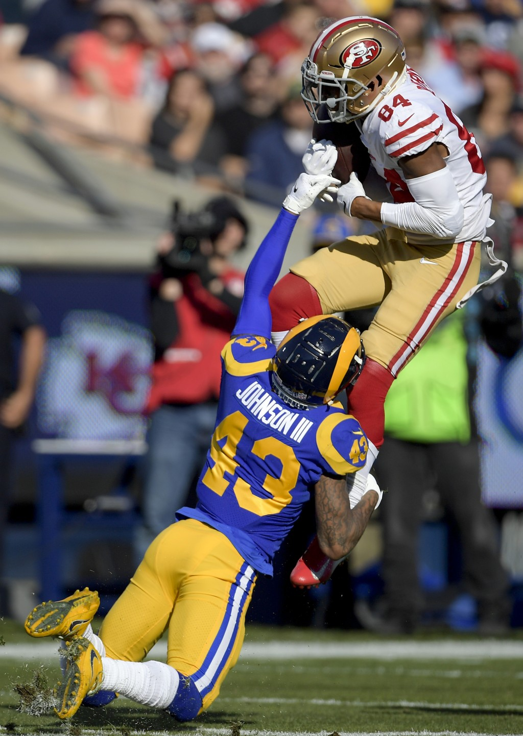 San Francisco 49ers wide receiver Kendrick Bourne, top, catches a pass over Los Angeles Rams strong safety John Johnson during the first half in an NF...