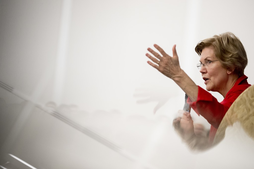 FILE - In this Nov. 29, 2018, file photo, Sen. Elizabeth Warren, D-Mass., answers a question from the audience at the American University Washington C...
