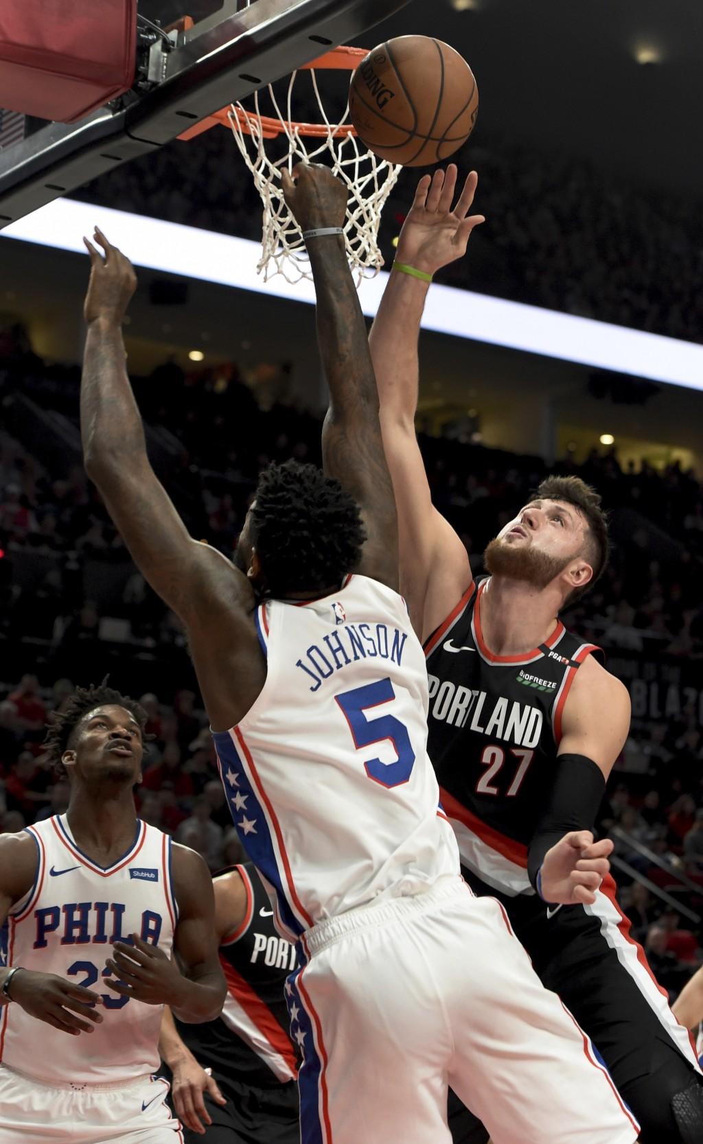 Portland Trail Blazers center Jusuf Nurkic, right, blocks the shot of Philadelphia 76ers center Amir Johnson, left, during the first half of an NBA ba...