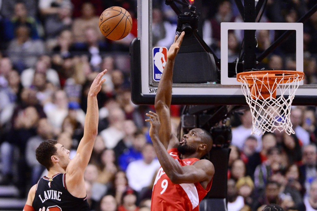 Toronto Raptors forward Serge Ibaka (9) blocks a shot from Chicago Bulls guard Zach LaVine (8) during second-half NBA basketball game action in Toront...