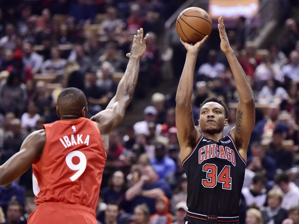 Chicago Bulls forward Wendell Carter Jr. (34) shoots over Toronto Raptors forward Serge Ibaka (9) during first-half NBA basketball game action in Toro...