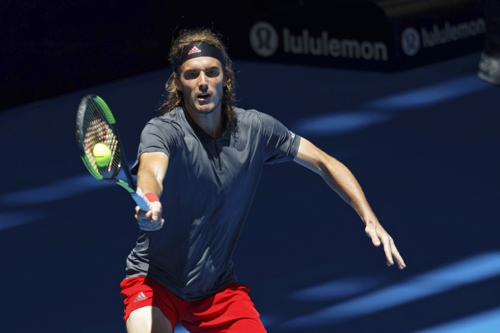Stefanos Tsitsipass of Greece returns during his match against Frances Tiafoe of the United States at the Hopman Cup in Perth, Australia, Monday Dec. ...