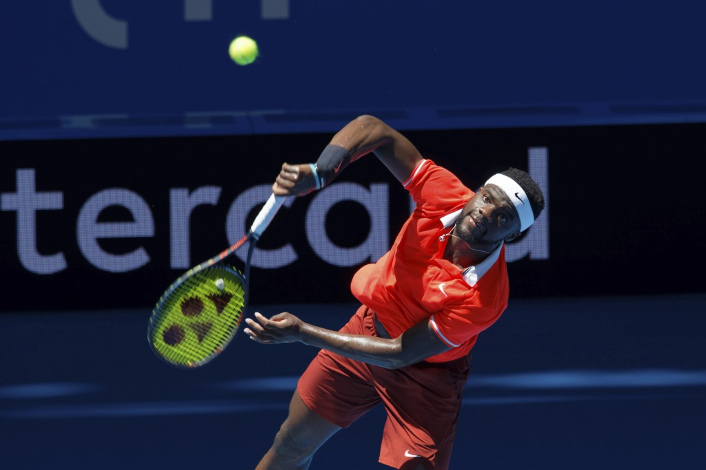 Frances Tiafoe of the United States returns during his match against Stefanos Tsitsipass of Greece at the Hopman Cup in Perth, Australia, Monday, Dec....