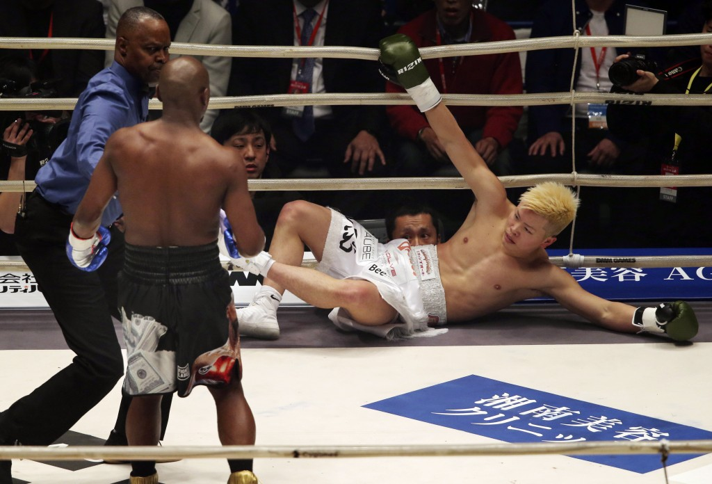 Japanese kickboxer Tenshin Nasukawa lies on the mat after being knocked out by Floyd Mayweather Jr. during first round of their three-round exhibition...