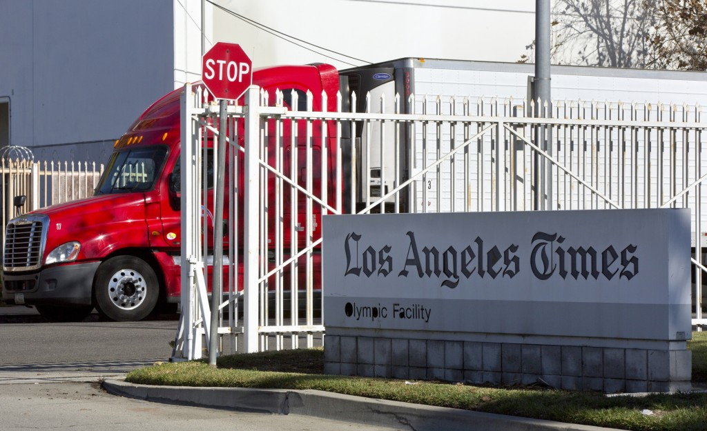 A truck is parked outside the Los Angeles Times Olympic Facility in Los Angeles, Sunday, Dec. 30, 2018. A computer virus hit the newspaper printing pl...