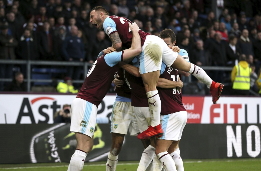 Burnley's Dwight McNeil, hidden, celebrates scoring his side's second goal of the game against West Ham United during their English Premier League soc...