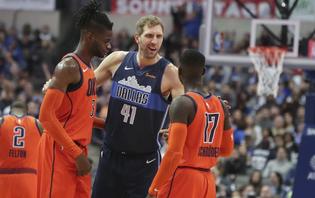 Dallas Mavericks forward Dirk Nowitzki (41), of Germany, greets Oklahoma City Thunder guard Dennis Schroder (17) and forward Nerlens Noel (3) during t...