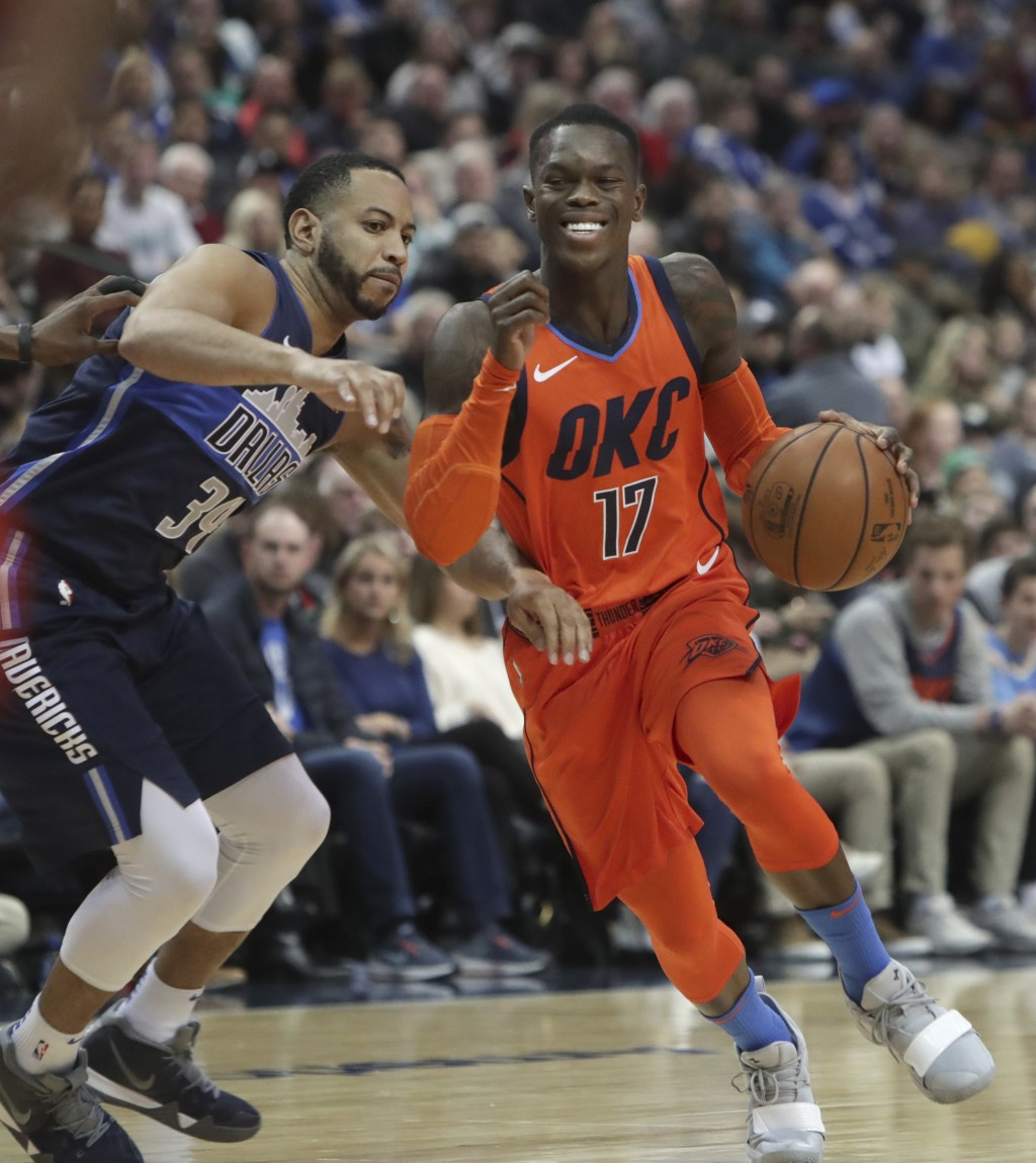 Oklahoma City Thunder guard Dennis Schroder (17), of Germany, drives against Dallas Mavericks guard Devin Harris (34) during the first half of an NBA ...