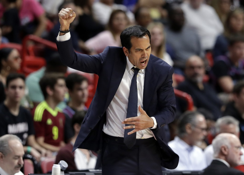 Miami Heat head coach Erik Spoelstra reacts during the first half of an NBA basketball game against the Minnesota Timberwolves, Sunday, Dec. 30, 2018,...