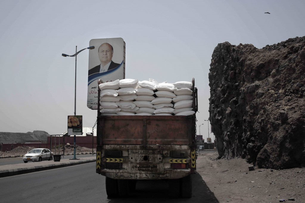 A truck carries aid on a road in Aden, Yemen, in this July 23, 2018, photo. Relief workers in Yemen said armed factions often manipulate lists of thos...