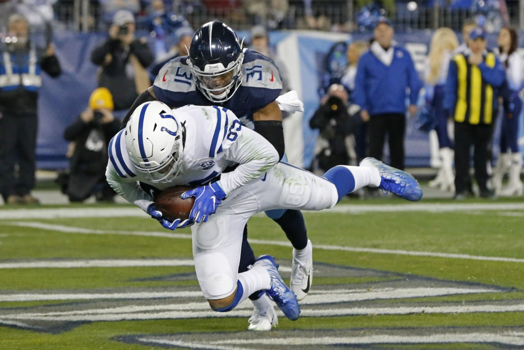 Indianapolis Colts tight end Eric Ebron (85) catches a 9-yard touchdown pass as he is defended by Tennessee Titans free safety Kevin Byard (31) in the...