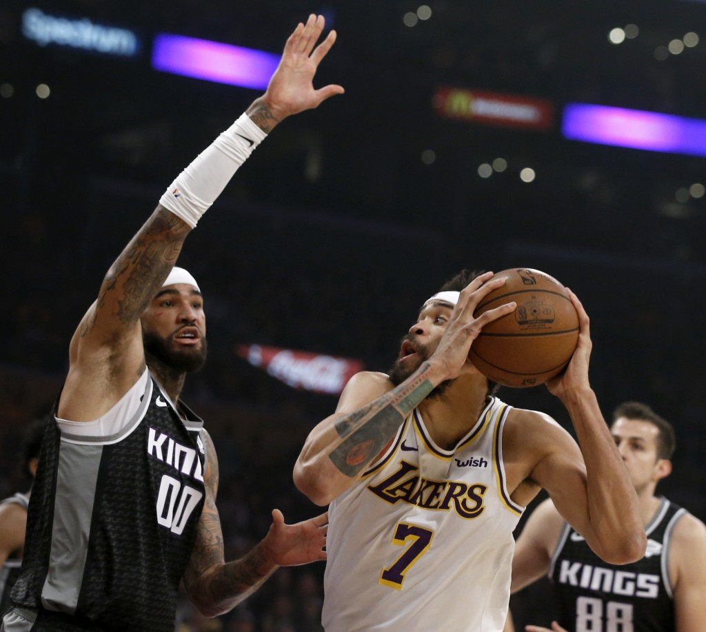 Los Angeles Lakers center JaVale McGee (7) looks to shoot against Sacramento Kings center Willie Cauley-Stein (00) during the first half of an NBA bas...