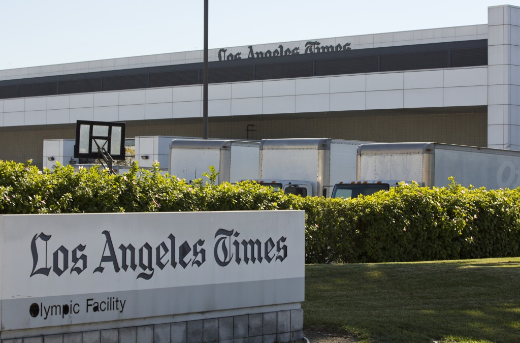 Delivery trucks are parked outside the Los Angeles Times Olympic Facility in Los Angeles, Sunday, Dec. 30, 2018. A computer virus hit the newspaper pr...