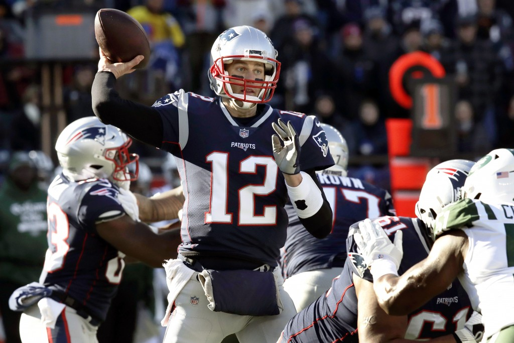New England Patriots quarterback Tom Brady passes under pressure from the New York Jets during the first half of an NFL football game, Sunday, Dec. 30...