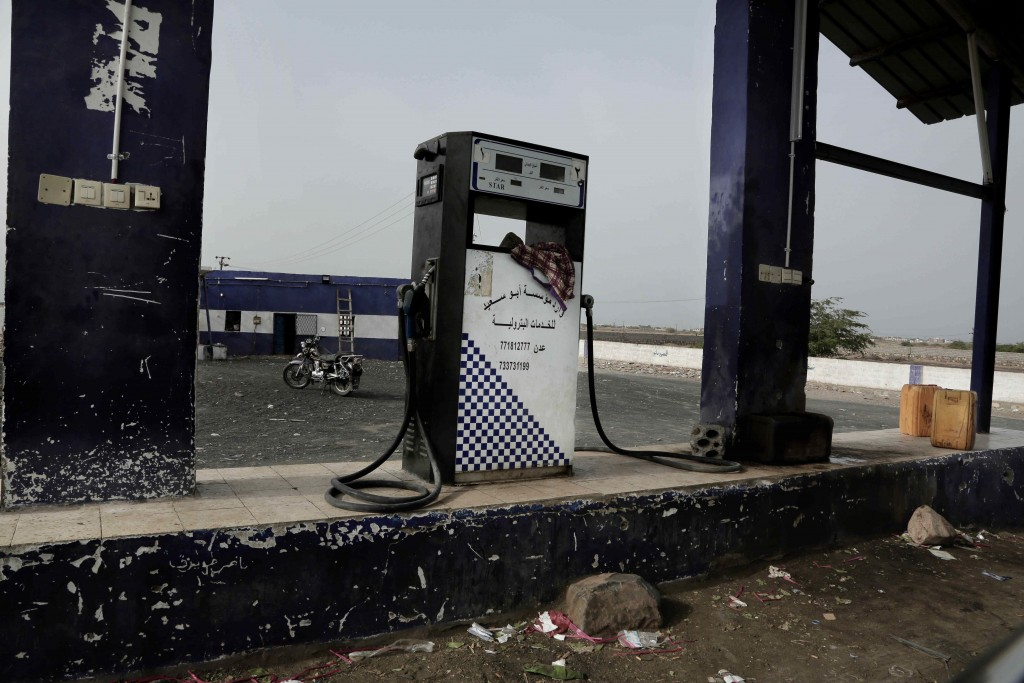 This July 24, 2018, photo shows a gas station on a road in Shabwah, Yemen. The civil war has pushed Yemen into economic collapse, with major fuel shor...