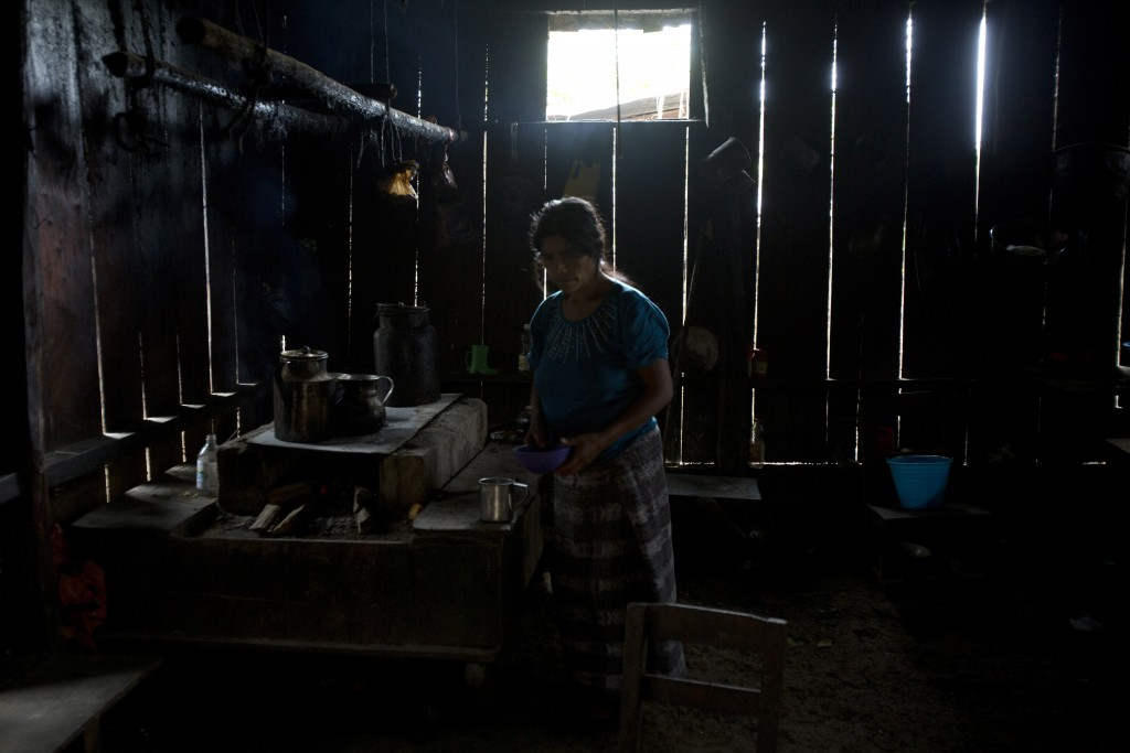 Maria Gomez, aunt of Felipe Gomez Alonzo, an 8-year-old Guatemalan boy who died in U.S. custody, works in her kitchen in Yalambojoch, Guatemala, Satur...