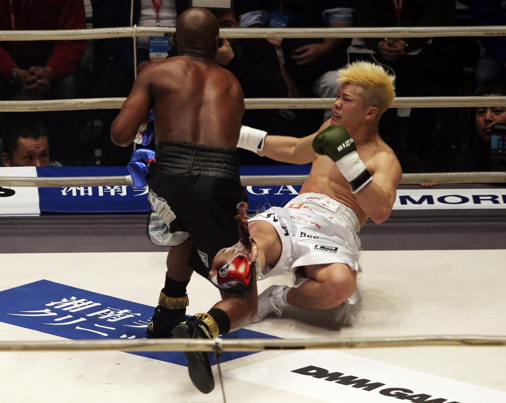 Japanese kickboxer Tenshin Nasukawa lies on the mat after being knocked out by Floyd Mayweather Jr. during first round of their three-round exhibition