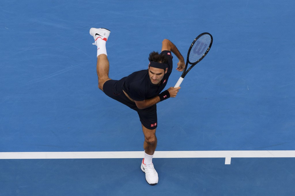 Switzerland's Roger Federer plays a shot during his match against at Frances Tiafoe of the United States at the Hopman Cup in Perth, Australia, Tuesda...