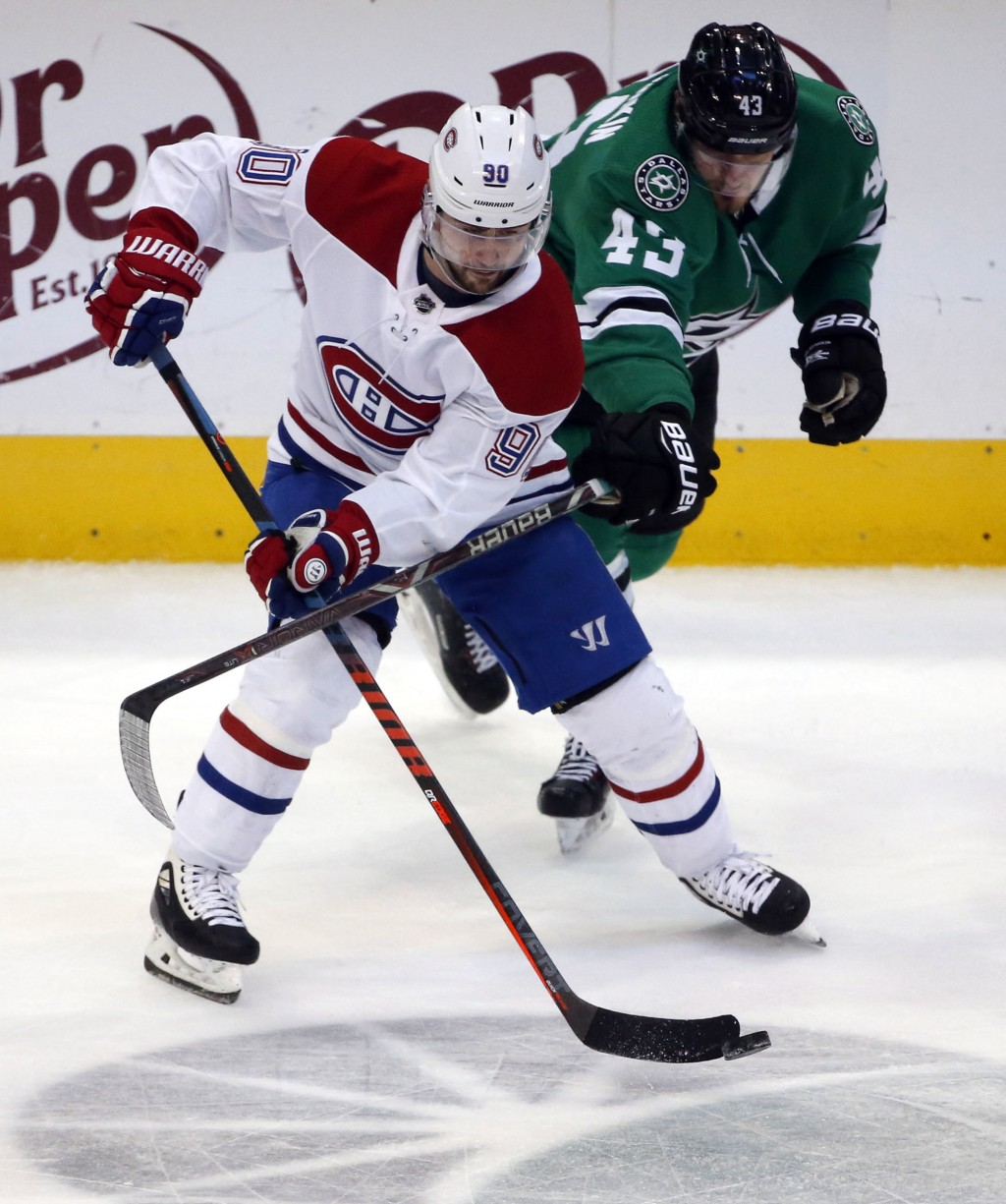 Dallas Stars right wing Valeri Nichushkin (43) defends against Montreal Canadiens left wing Tomas Tatar (90) during the second period of an NHL hockey...