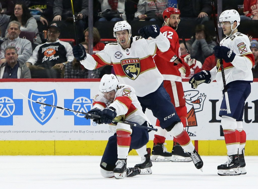 Florida Panthers center Jayce Hawryluk (8) celebrates with right wing Juho Lammikko (91), of Finland, after scoring against the Detroit Red Wings duri...