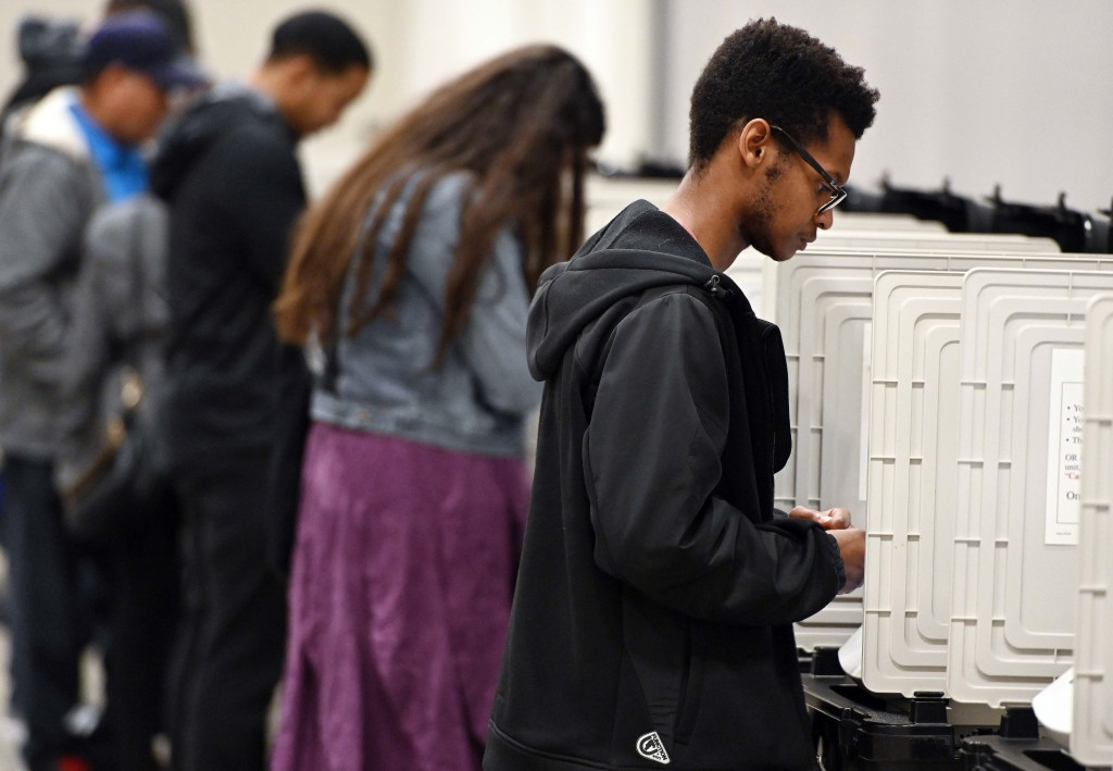 FILE - In this Oct. 27, 2018 file photo, people cast their ballots ahead of the Nov. 6, general election at Jim Miller Park in Marietta, Ga. Georgia's