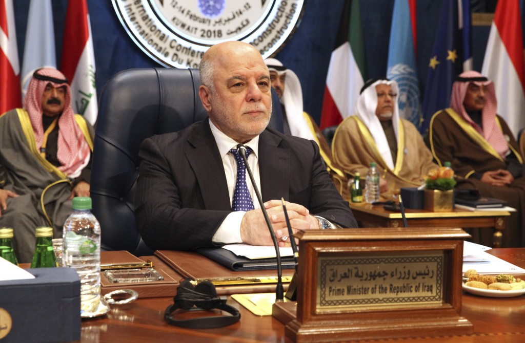 FILE - Int this Feb. 14, 2018  file photo, (then) Iraqi Prime Minister Haider al-Abadi prepares for a donor's summit seeking billions of dollars to he...