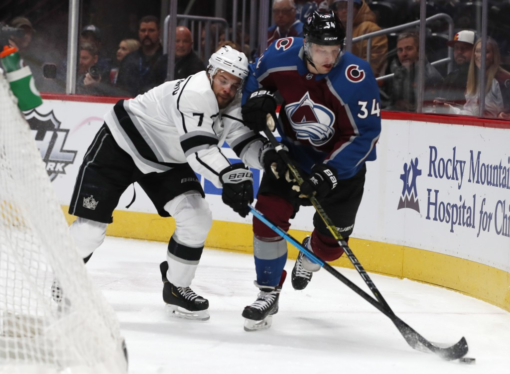 Los Angeles Kings defenseman Oscar Fantenberg, left, defends against Colorado Avalanche center Carl Soderberg durin the first period of an NHL hockey ...