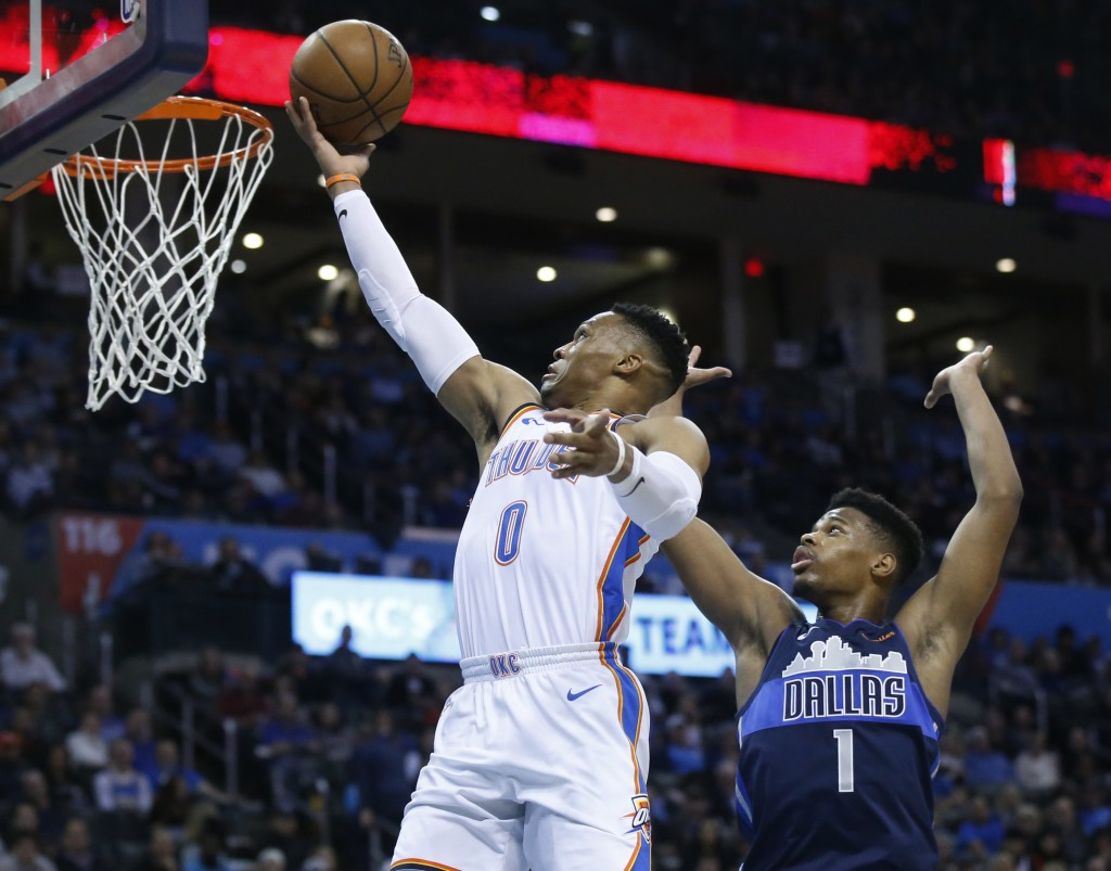 Oklahoma City Thunder guard Russell Westbrook (0) shoots in front of Dallas Mavericks guard Dennis Smith Jr. (1) in the second half of an NBA basketba...