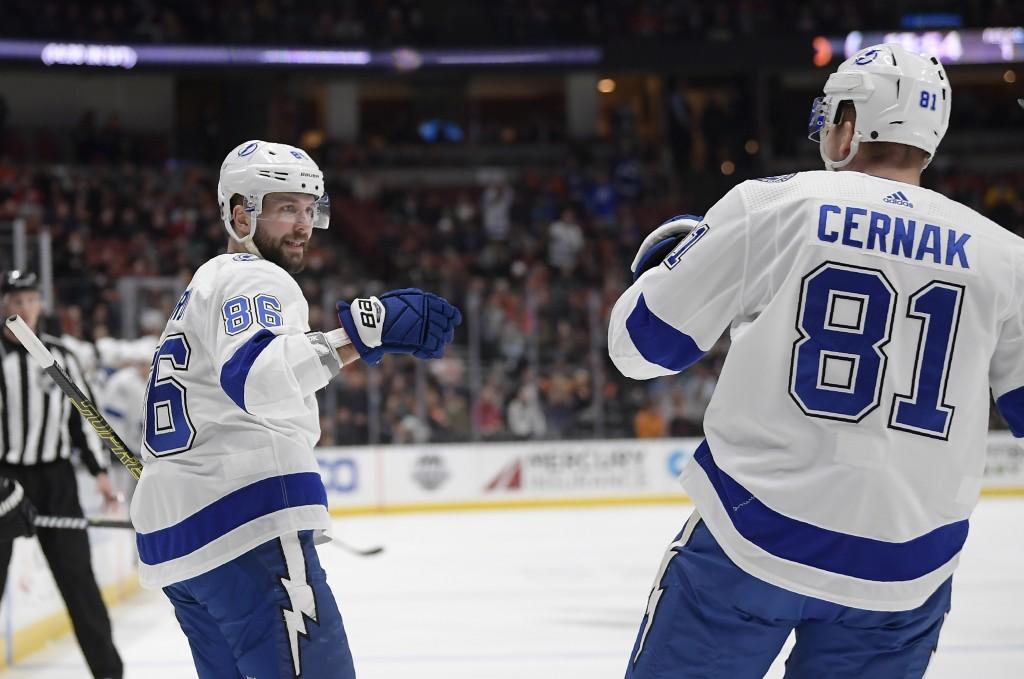 Tampa Bay Lightning right wing Nikita Kucherov, left, celebrates his goal with defenseman Erik Cernak during the first period of an NHL hockey game ag...