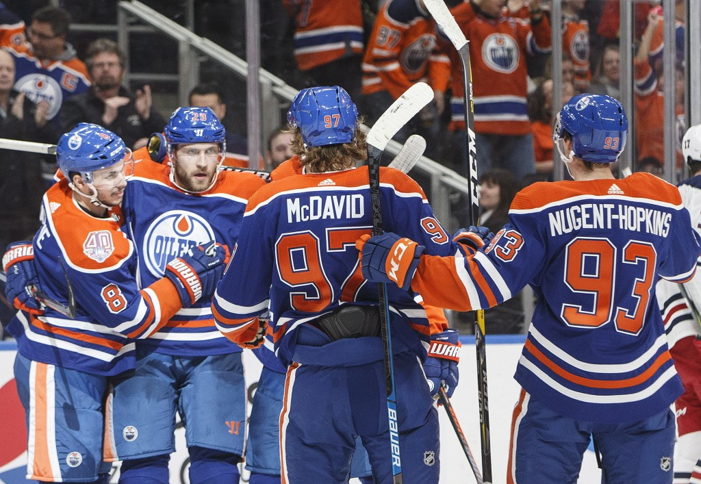Edmonton Oilers' Ty Rattie (8), Leon Draisaitl (29), Connor McDavid (97) and Ryan Nugent-Hopkins (93) celebrate a goal agaisnt the Winnipeg Jets durin...
