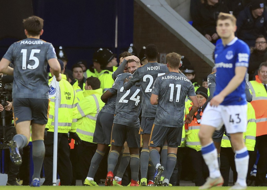 Leicester City's Jamie Vardy looks out as he is mobbed by team-mates after scoring his sides first goal of the game against Everton, during their Engl