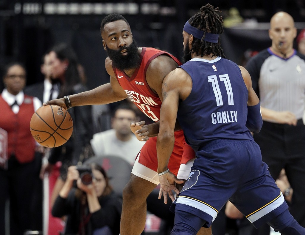 Houston Rockets guard James Harden (13) looks to pass the ball under pressure from Memphis Grizzlies guard Mike Conley (11) during the first half of a