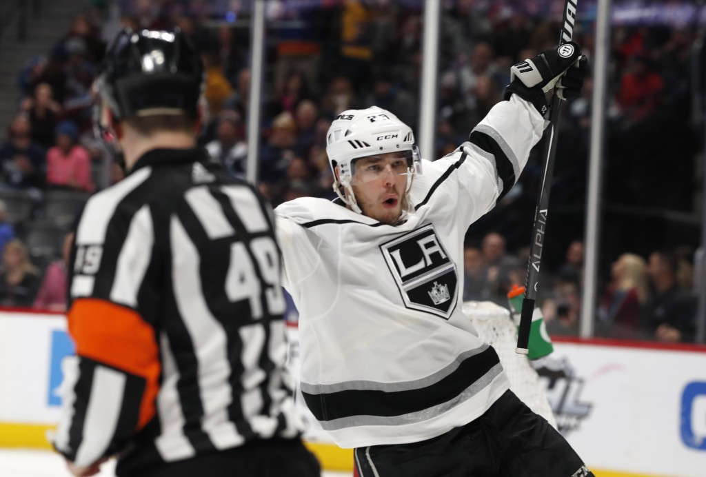Los Angeles Kings right wing Dustin Brown celebrates his overtime goal against the Colorado Avalanche next to official Reid Anderson during an NHL hoc...