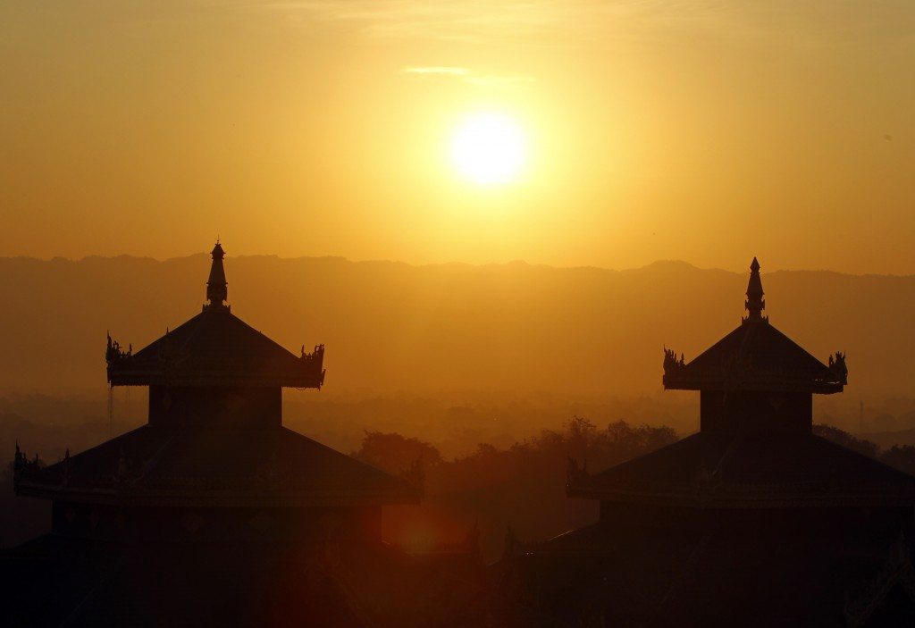In this Tuesday, Jan. 1, 2019, file photo, the sun rises above mountain ranges on the New Year day in Naypyitaw, Myanmar, Tuesday, Jan. 1, 2019. (AP P...