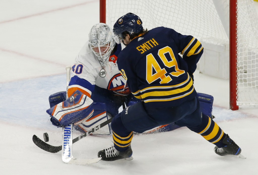 Buffalo Sabres forward C.J. Smith (49) is stopped by New York Islanders goalie Robin Lehner (40) during the third period of an NHL hockey game, Monday...