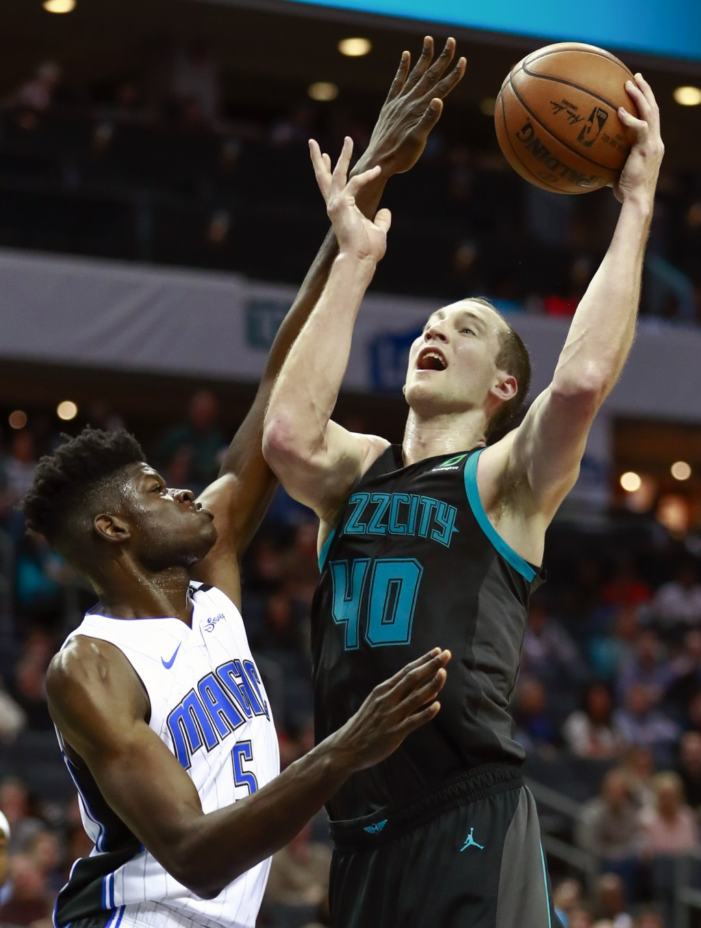 Charlotte Hornets center Cody Zeller (40) goes up ...