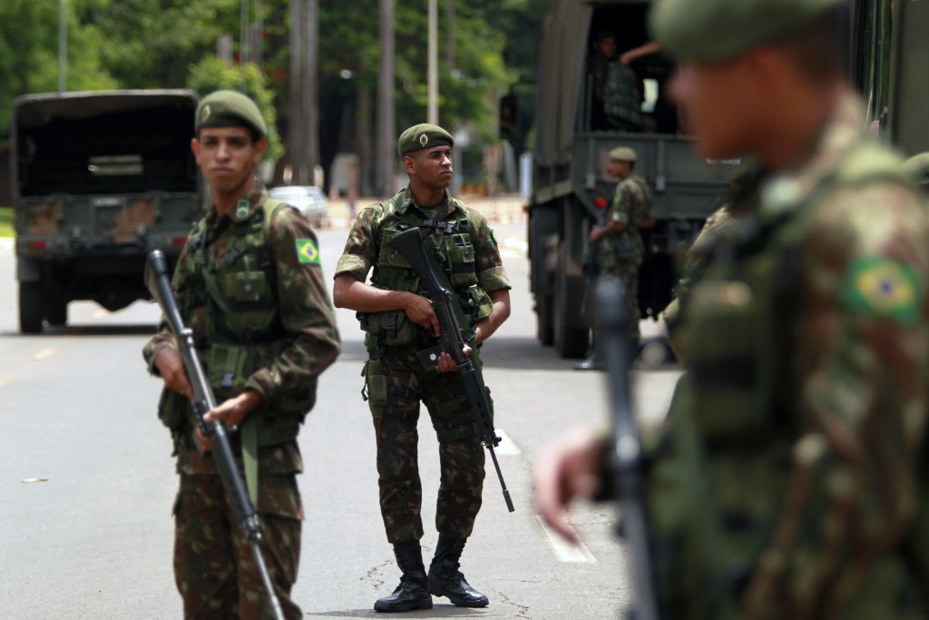 Army soldiers move during security preparations for Tuesday's inauguration ceremony of Brazil's President-elect Jair Bolsonaro, in Brasília, Brazil, M