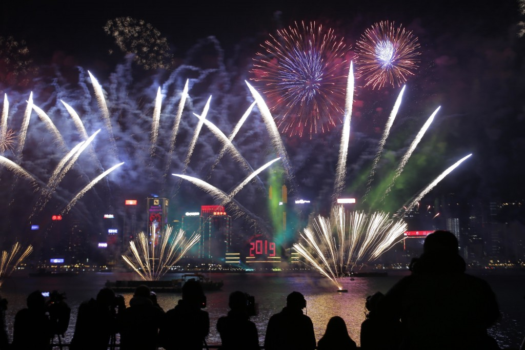 In this Tuesday, Jan. 1, 2019, file photo, fireworks explode over the Victoria Harbor during New Year's Eve to celebrate the start of year 2019 in Hon...
