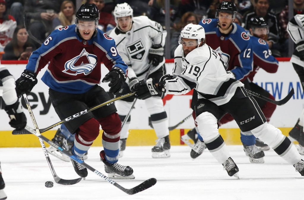 Los Angeles Kings left wing Alex Iafallo, right, fights for control of the puck with Colorado Avalanche right wing Mikko Rantanen during the first per