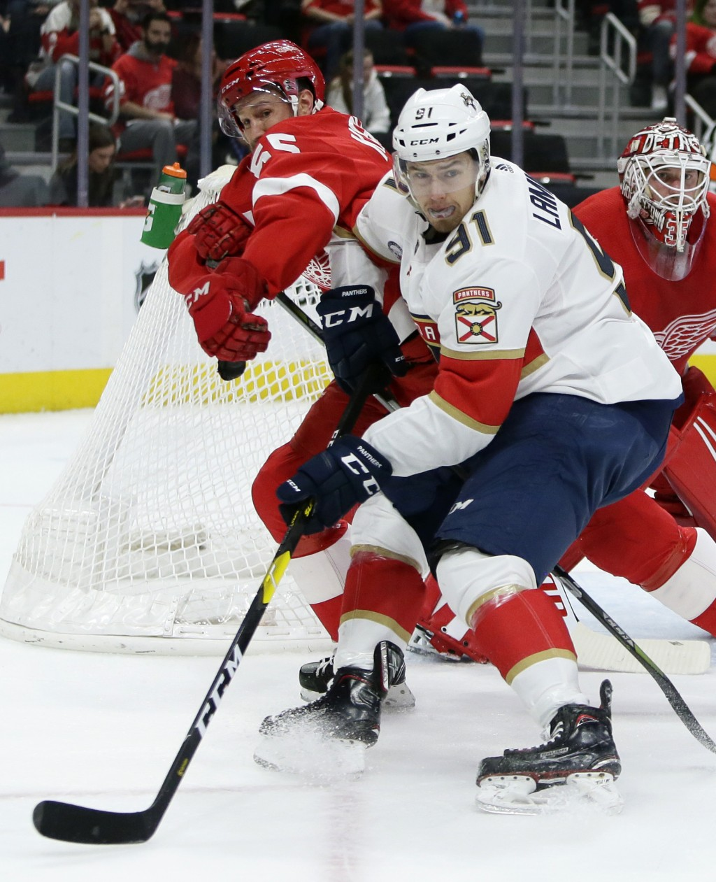 Detroit Red Wings defenseman Niklas Kronwall (55), of Sweden, pushes Florida Panthers right wing Juho Lammikko (91), of Finland, away from the net dur