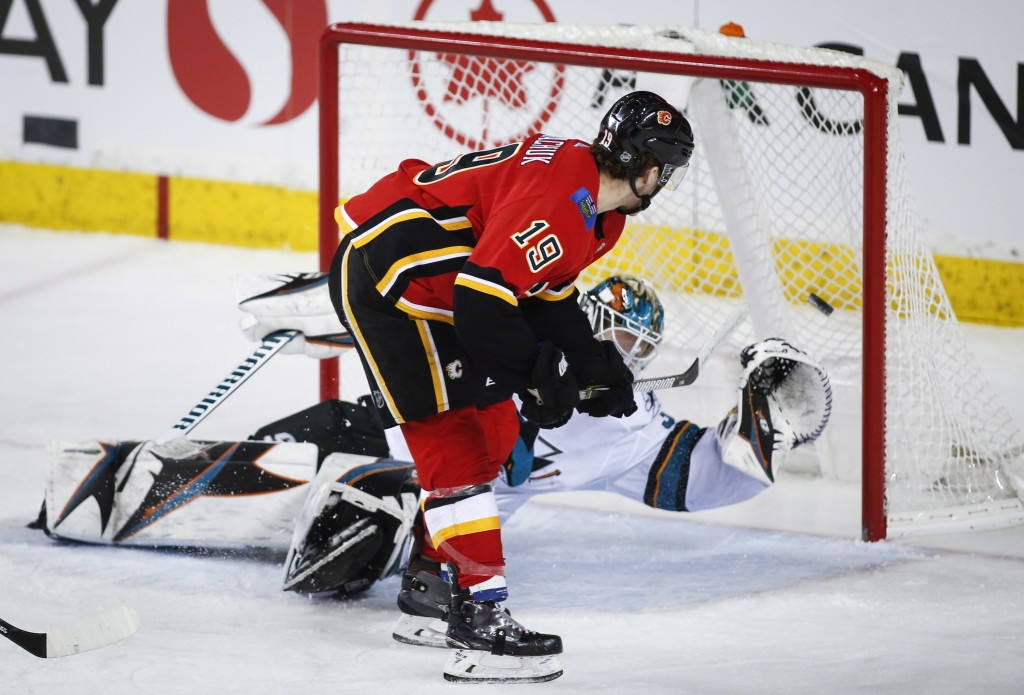 San Jose Sharks goalie Aaron Dell lets in a goal from Calgary Flames' Matthew Tkachuk during the second period of an NHL hockey game Monday, Dec. 31,