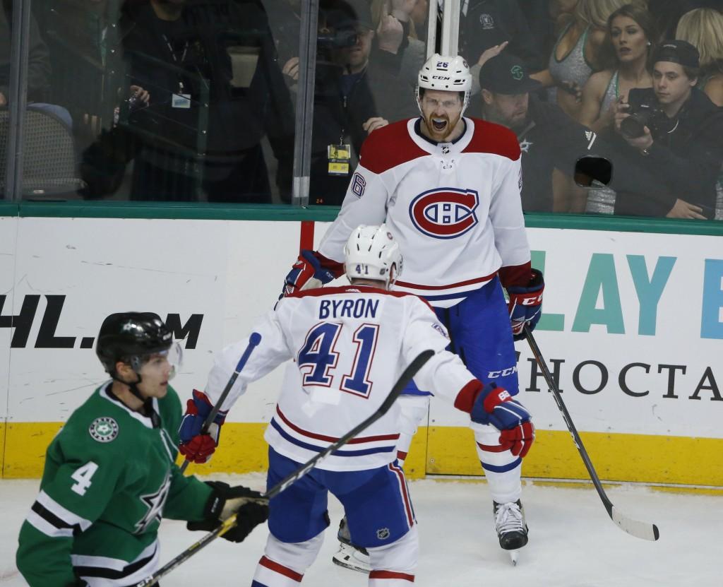 Montreal Canadiens defenseman Jeff Petry (26) celebrates his winning goal with left wing Paul Byron (41) as Dallas Stars defenseman Miro Heiskanen (4)