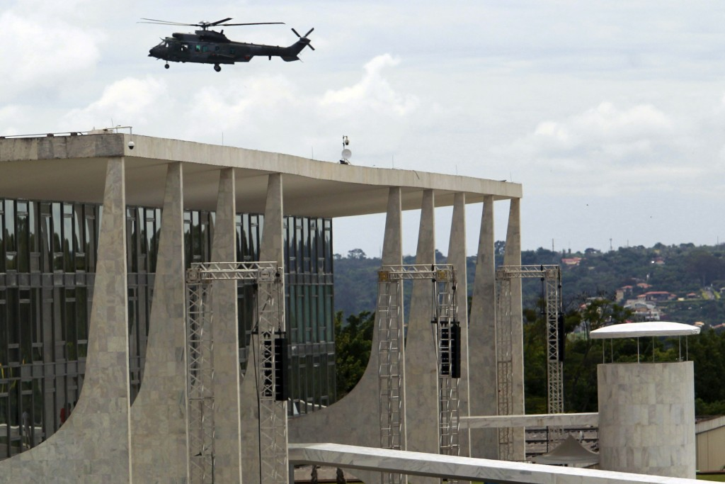 An army helicopter flies over Planalto Presidential palace, during security preparations for Tuesday's inauguration ceremony of Brazil's President-ele