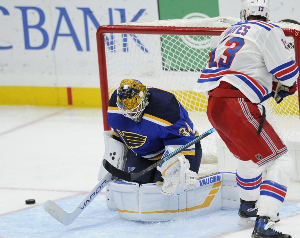St. Louis Blues goalie Jake Allen (34) blocks a shot by New York Rangers' Kevin Hayes (13) during the third period of an NHL hockey game Monday, Dec.