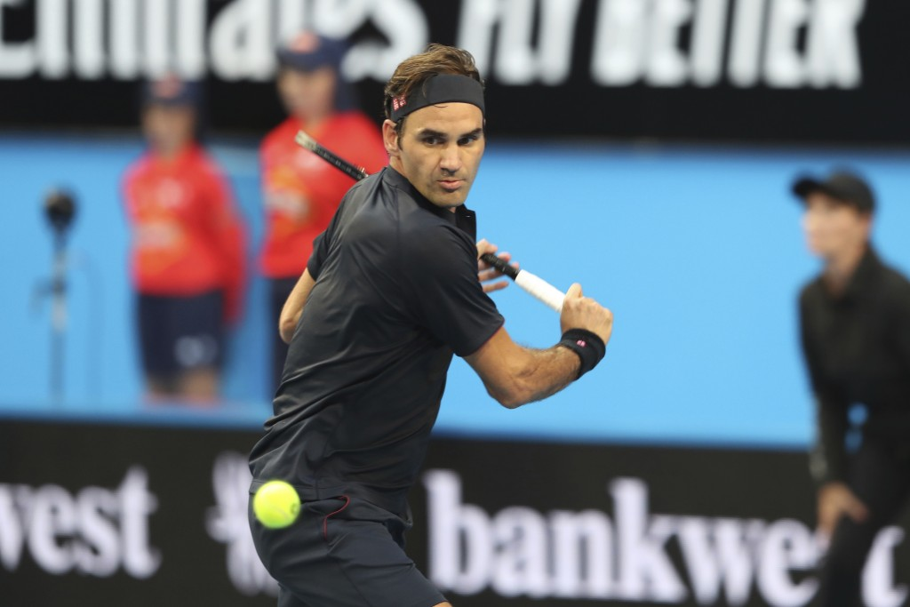 Switzerland's Roger Federer plays a shot during his match against at Frances Tiafoe of the United States at the Hopman Cup in Perth, Australia, Tuesda