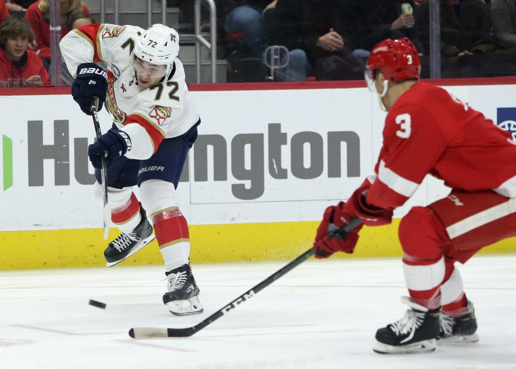 Florida Panthers center Frank Vatrano (72) takes a shot on goal against Detroit Red Wings defenseman Nick Jensen (3) during the first period of an NHL