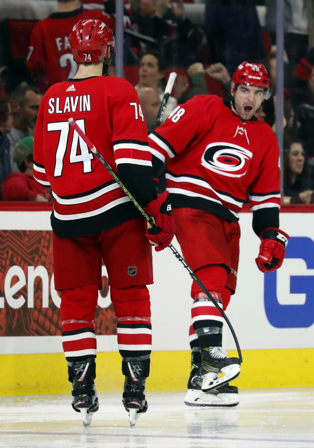 Carolina Hurricanes' Jordan Martinook (48) celebrates his goal with teammate Jaccob Slavin (74) during the second period of an NHL hockey game against...