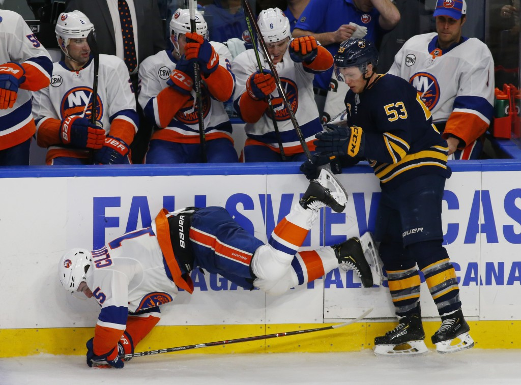 Buffalo Sabres forward Jeff Skinner (53) and New York Islanders forward Cal Clutterbuck (15) collide during the third period of an NHL hockey game, Mo...
